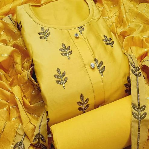 Charming Yellow Colored Partywear Embroidered Cotton Dress Material