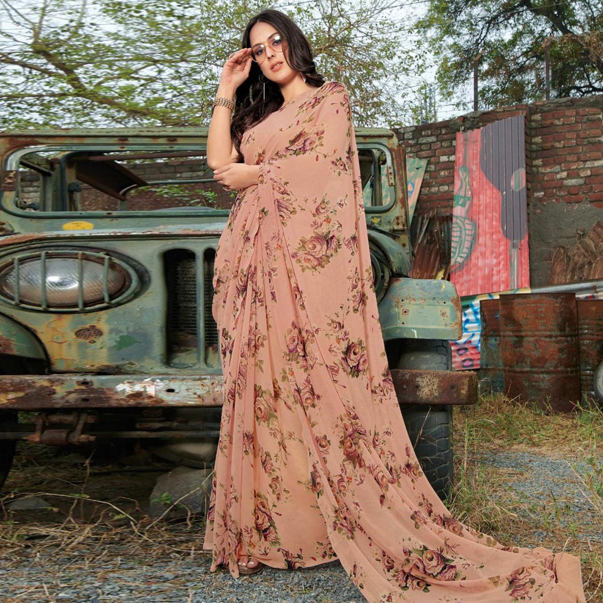 Mesmerising Peach Colored Casual Wear Floral Printed Gerogette Saree