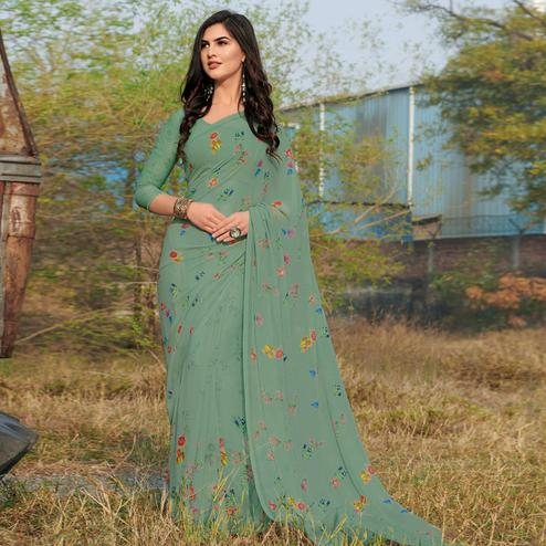 Staring Ocean Green Colored Casual Wear Floral Printed Gerogette Saree