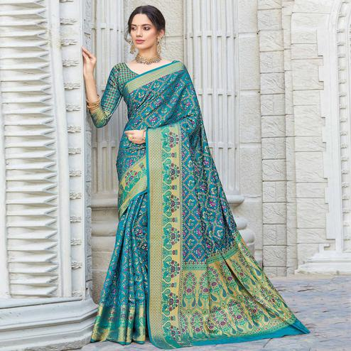 Flaunt Turquoise Blue Colored Festive Wear Woven Patola Silk Saree