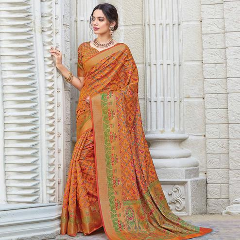 Stunning Orange Colored Festive Wear Woven Patola Silk Saree