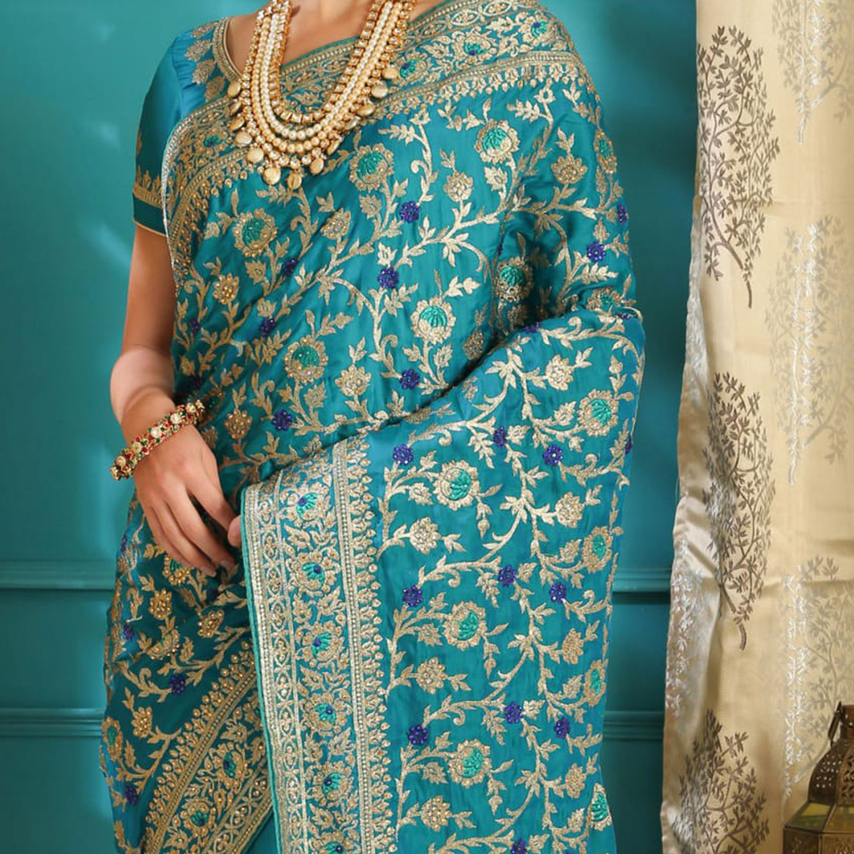 Trendy Teal Blue Colored Party Wear Embroidered Silk Saree