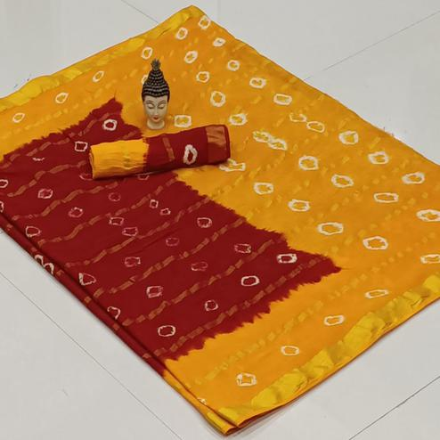 Mesmeric Red-Yellow Colored Party Wear Bandhani Print Cotton Saree