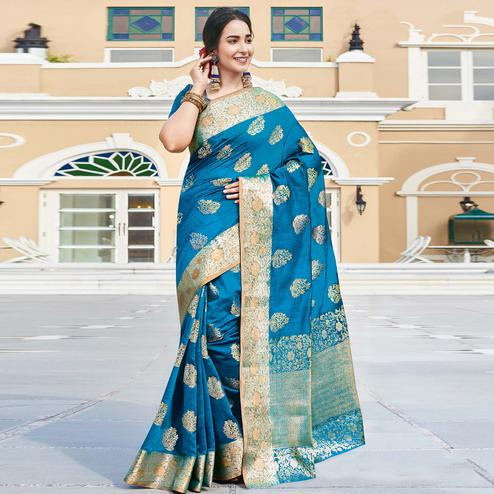 Blissful Turquoise Blue Colored Festive Wear Woven Silk Saree