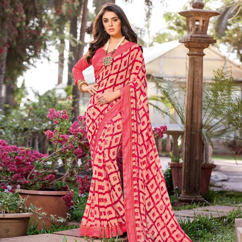 Intricate Peach Colored Partywear Printed Georgette Saree