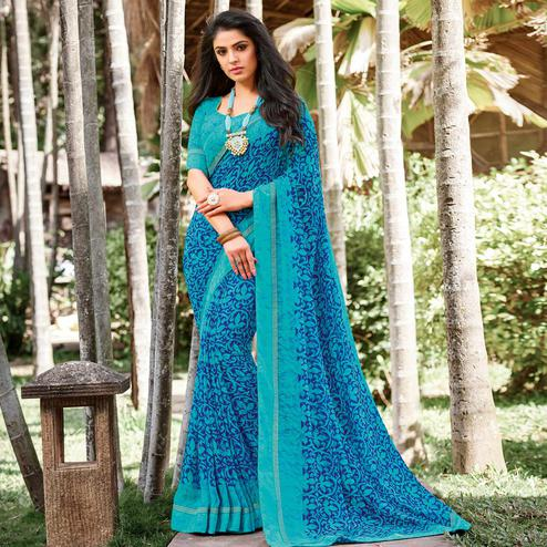 Pleasant Blue Colored Partywear Printed Georgette Saree