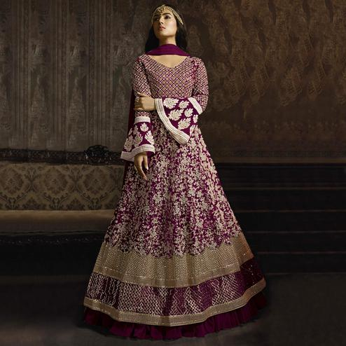 Beautiful Purple Colored Partywear Embroidered Bell Sleeve Net Anarkali Suit