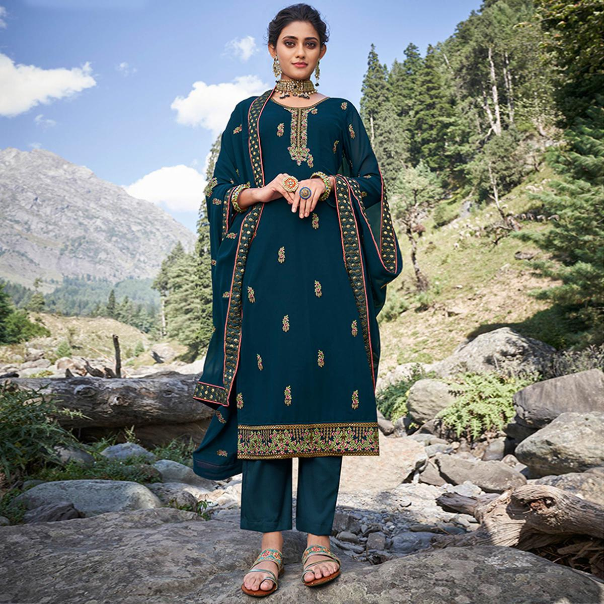 Adorning Peacock Blue Colored Party Wear Floral Embroidered Georgette Suit