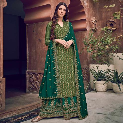 Ethnic Green Colored Partywear Embroidered Pure Dola Jacquard Palazzo Suit