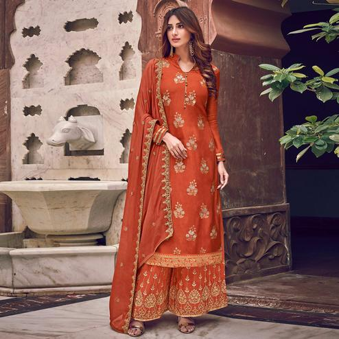 Surpassing Orange Colored Partywear Embroidered Pure Dola Jacquard Palazzo Suit