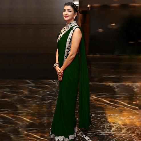 Entrancing Dark Green Colored Party Wear Embroidered Georgette Saree