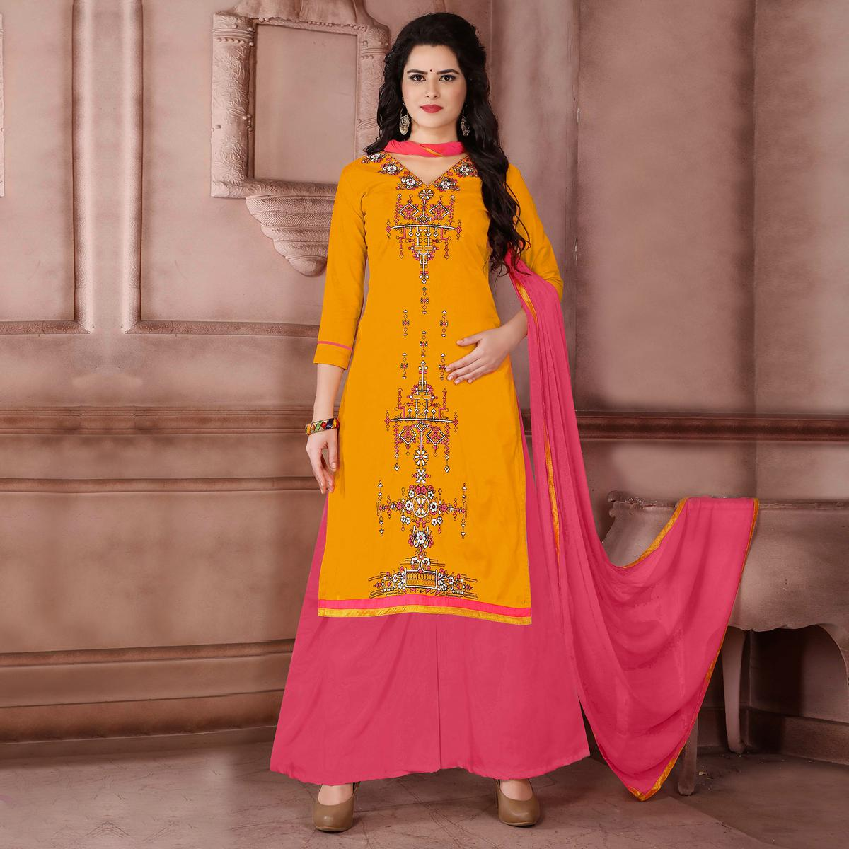 Ravishing Dark Yellow Designer Embroidered Cambric Cotton Palazzo Suit