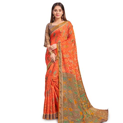 Magnetic Orange Colored Festive Wear Woven Two Tone Brasso Saree