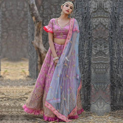 Hypnotic Pink Colored Party Wear Embroidered Net Lehenga Choli