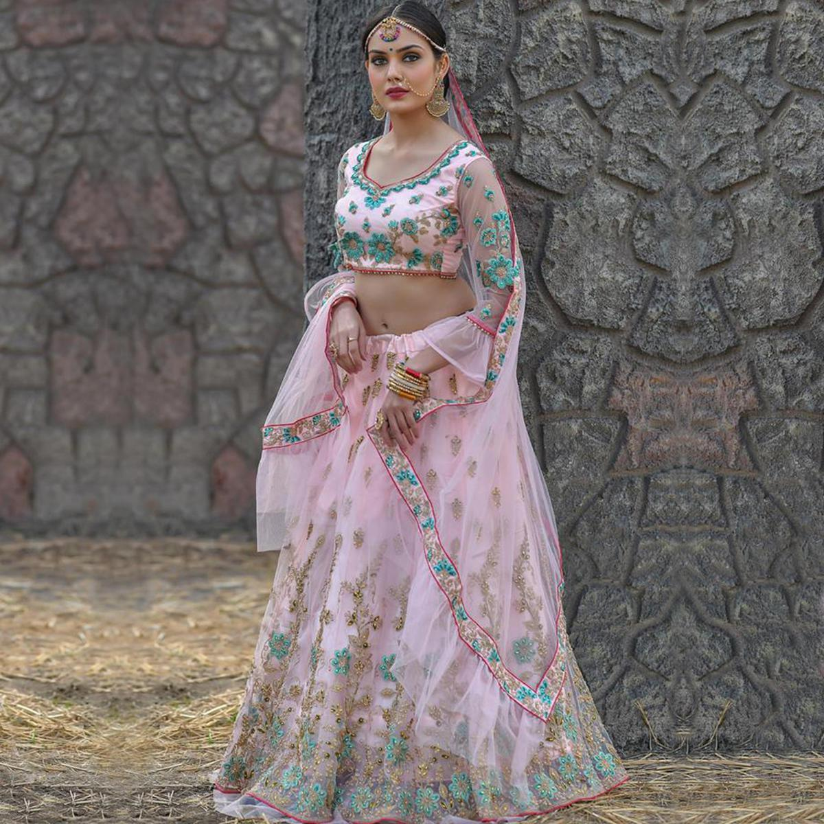 Excellent Baby Pink Colored Party Wear Embroidered Net Lehenga Choli