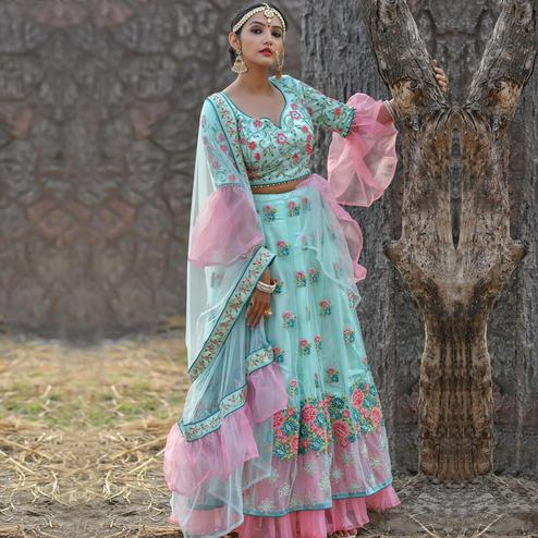 Preferable Turquoise Blue Colored Party Wear Embroidered Net Lehenga Choli