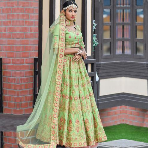Magnetic Green Colored Party Wear Embroidered Silk Lehenga Choli