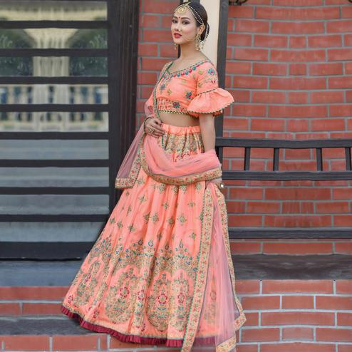 Hypnotic Peach Colored Party Wear Embroidered Silk Lehenga Choli