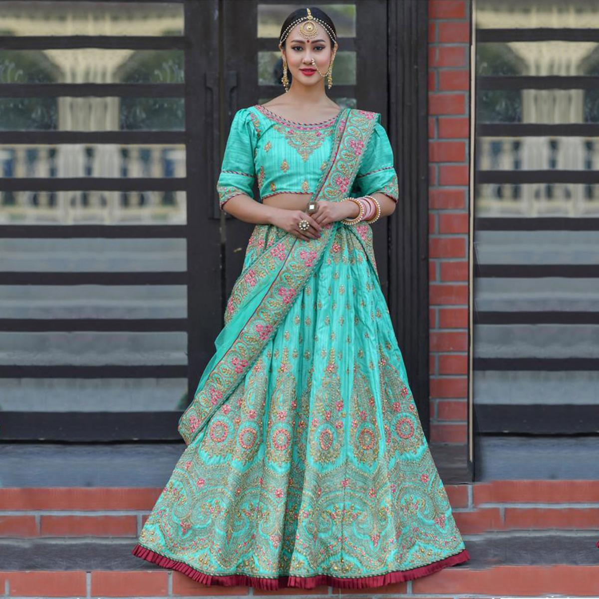 Preferable Turquoise Colored Party Wear Embroidered Silk Lehenga Choli