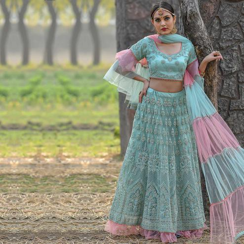 Gorgeous Blue Colored Party Wear Embroidered Net Lehenga Choli