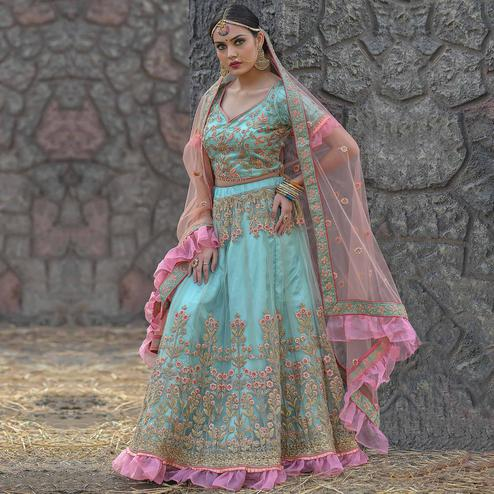 Imposing Turquoise Colored Party Wear Embroidered Net Lehenga Choli