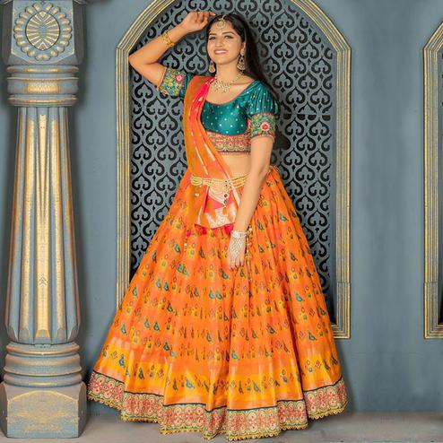 Preferable Orange Colored Party Wear Woven Banarasi Silk Lehenga Choli