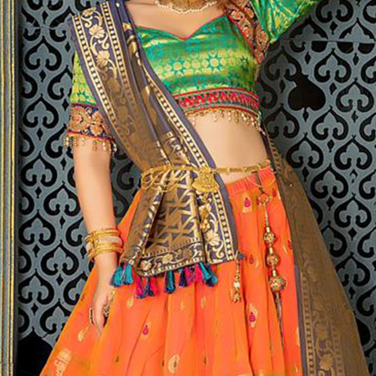 Magnetic Orange Colored Party Wear Woven Jacquard Lehenga Choli