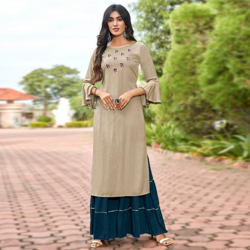 Gleaming Beige Colored Partywear Embroidered Heavy Rayon Sharara Suit