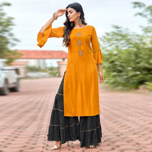 Unique Orange Colored Partywear Embroidered Heavy Rayon Sharara Suit