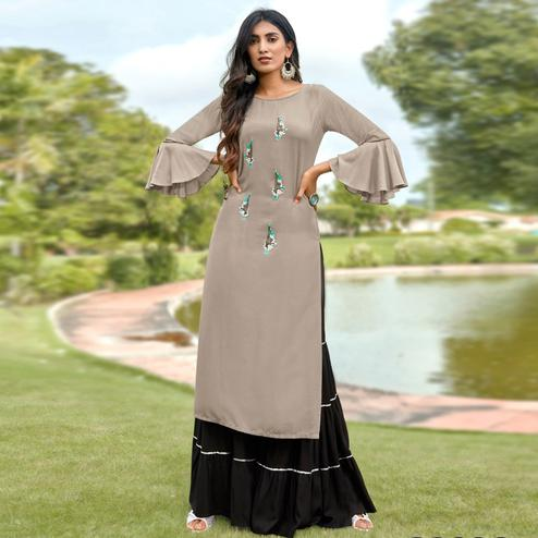 Demanding Light Grey Colored Partywear Embroidered Heavy Rayon Sharara Suit
