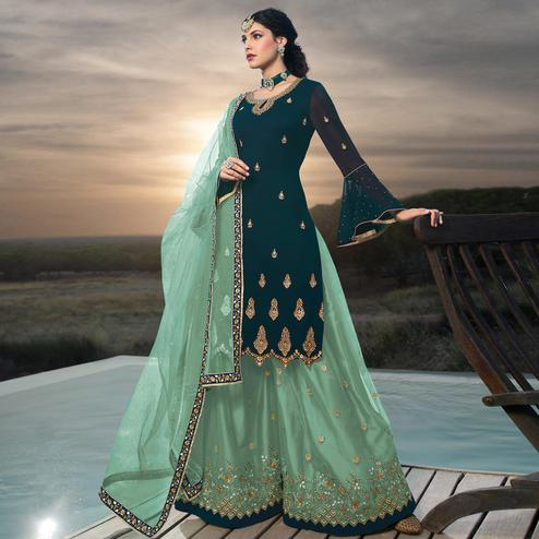 Flattering Teal Blue Colored Designer Partywear Embroidered Faux Georgette Lehenga Kameez