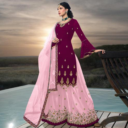 Excellent Rani Colored Designer Partywear Embroidered Faux Georgette Lehenga Kameez