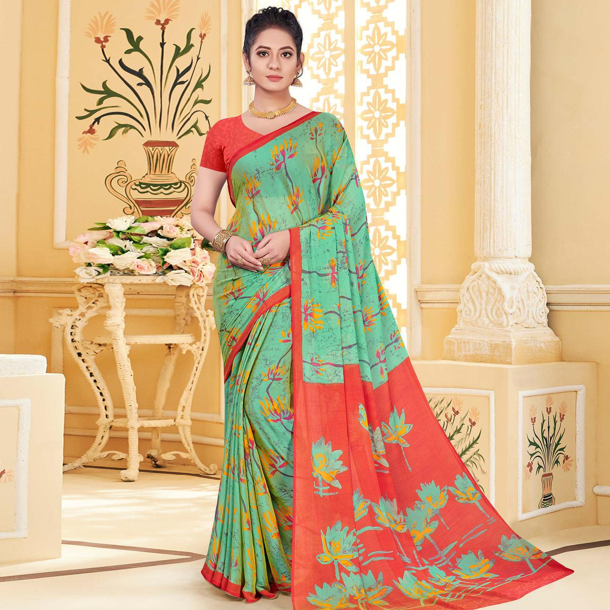 Graceful Aqua Green Colored Casual Wear Printed Chiffon Saree