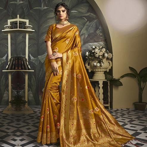 Eye-catching Rust Orange Colored Festive Wear Woven Jacquard Silk Saree With Tassels