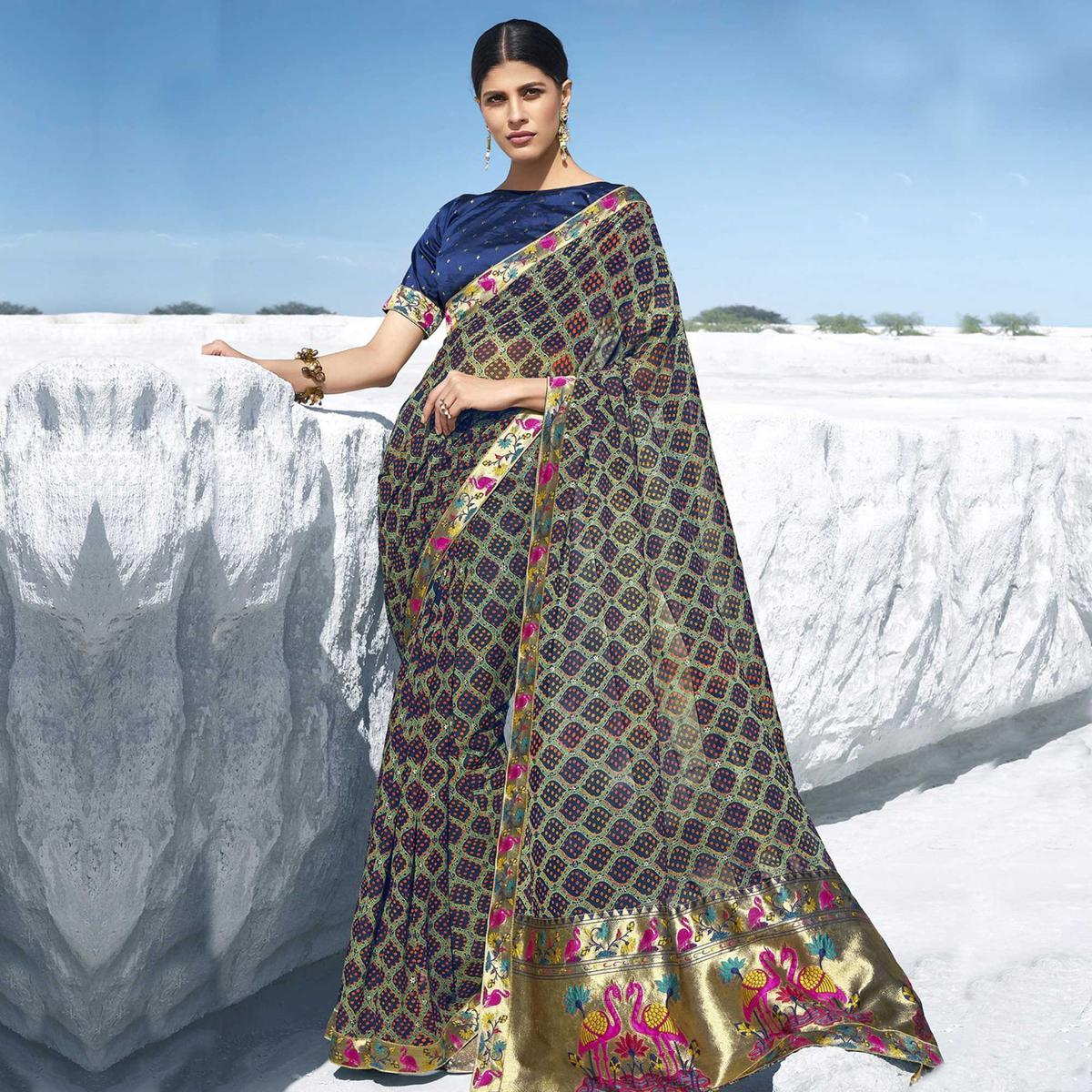 Ideal Navy Blue Colored Festive Wear Printed Georgette Saree With Tassles