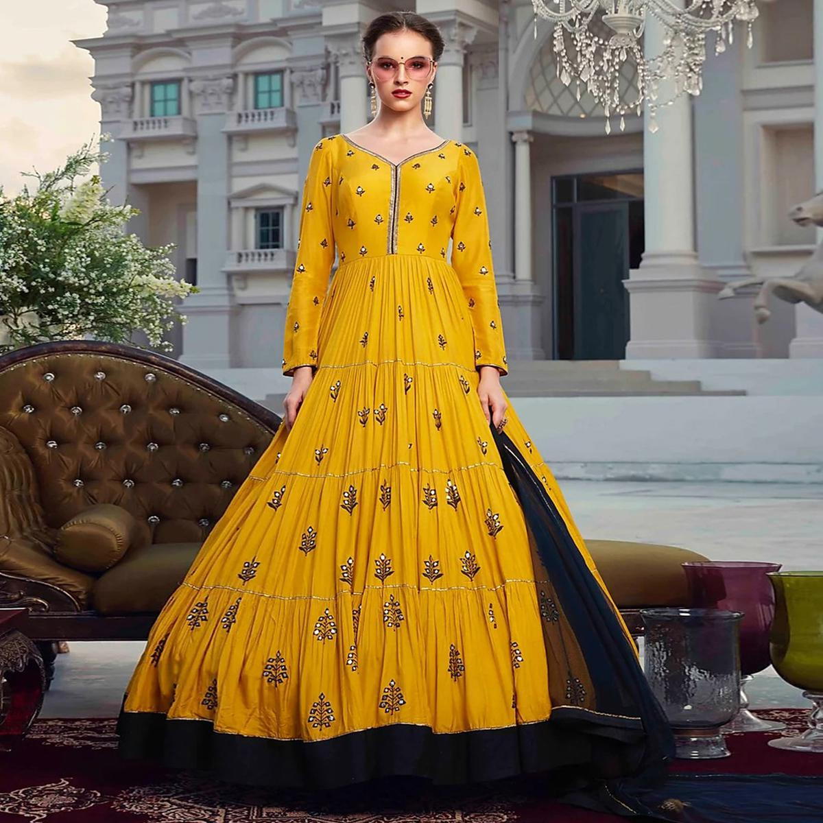 Energetic Mustard Yellow Colored Partywear Embroidered Heavy Faux Georgette Gown
