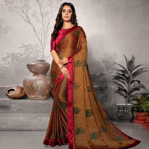 Flattering Orange Colored Partywear Printed Chiffon Saree