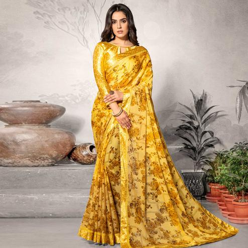 Flamboyant Yellow Colored Partywear Printed Chiffon Saree