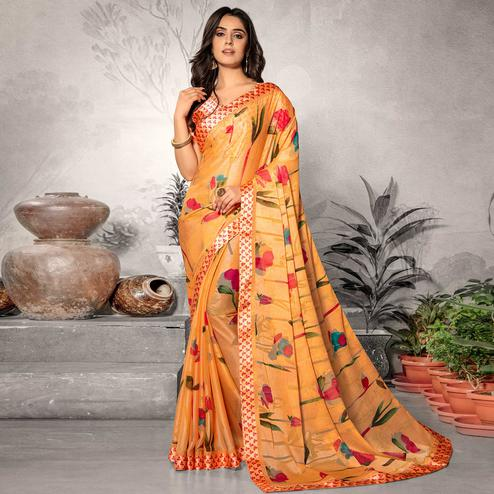 Flaunt Orange Colored Partywear Printed Chiffon Saree