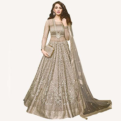 Graceful Beige Designer Embroidered Net Lehenga Kameez