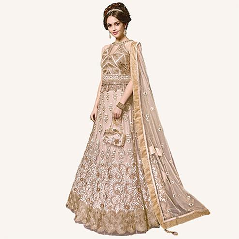 Attractive Beige Designer Embroidered Net Lehenga Choli