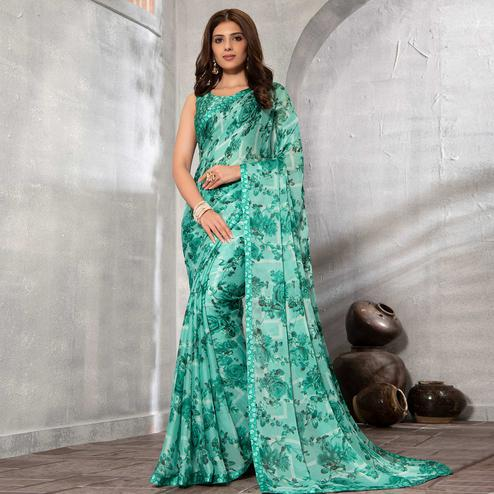 Ideal Turquoise Green Colored Partywear Floral Printed Chiffon Saree