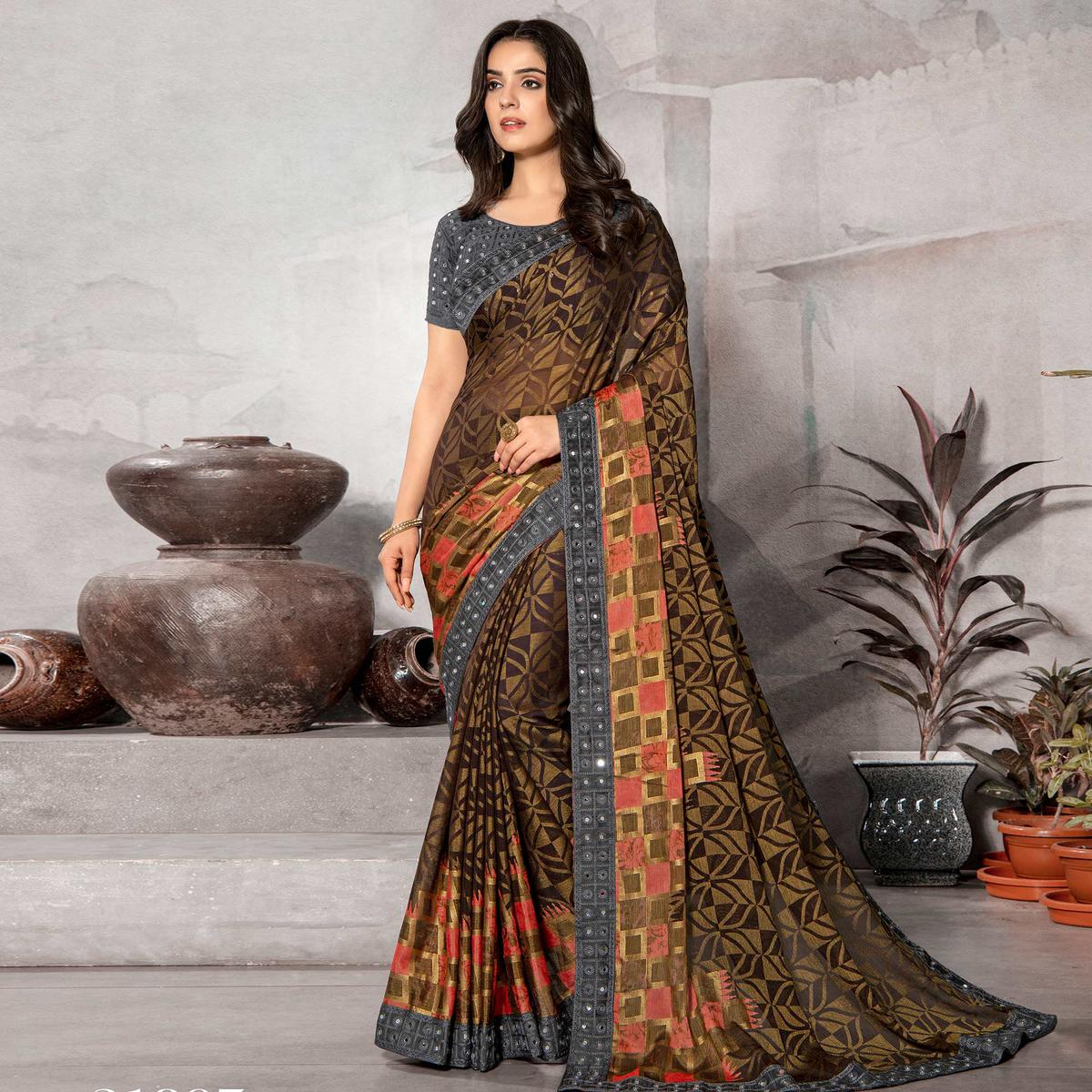 Dazzling Brown Colored Partywear Embroidered Chiffon Brasso Saree