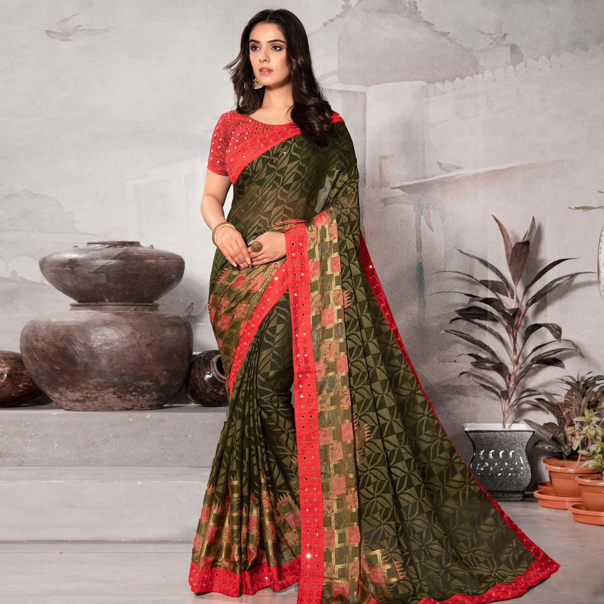Surpassing Mehendi Green Colored Partywear Embroidered Chiffon Brasso Saree