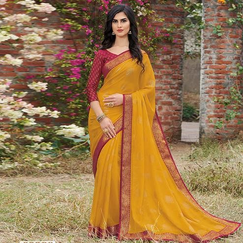 Stunning Yellow Colored Partywear Woven Georgette Saree