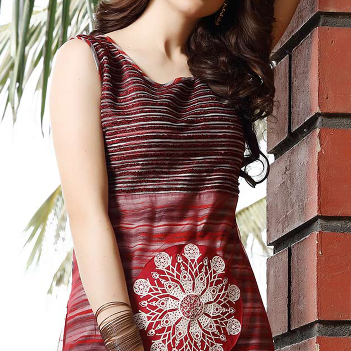 Flamboyant Maroon Designer Patch Worked Net And Rayon Kurti