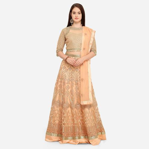 Stylee Lifestyle - Peach Colored Party Wear Embroidered Net Lehenga Choli