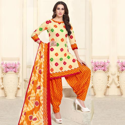 Charming Cream-Orange Colored Casual Wear Printed Cotton Patiala Dress Material