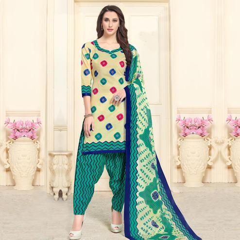 Fantastic Cream-Blue Colored Casual Wear Printed Cotton Patiala Dress Material