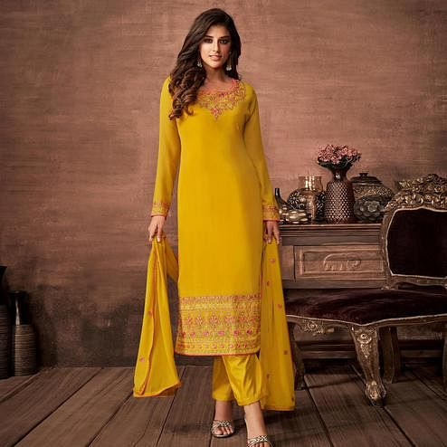 Charming Yellow Colored Partywear Woven Georgette Straight Suit